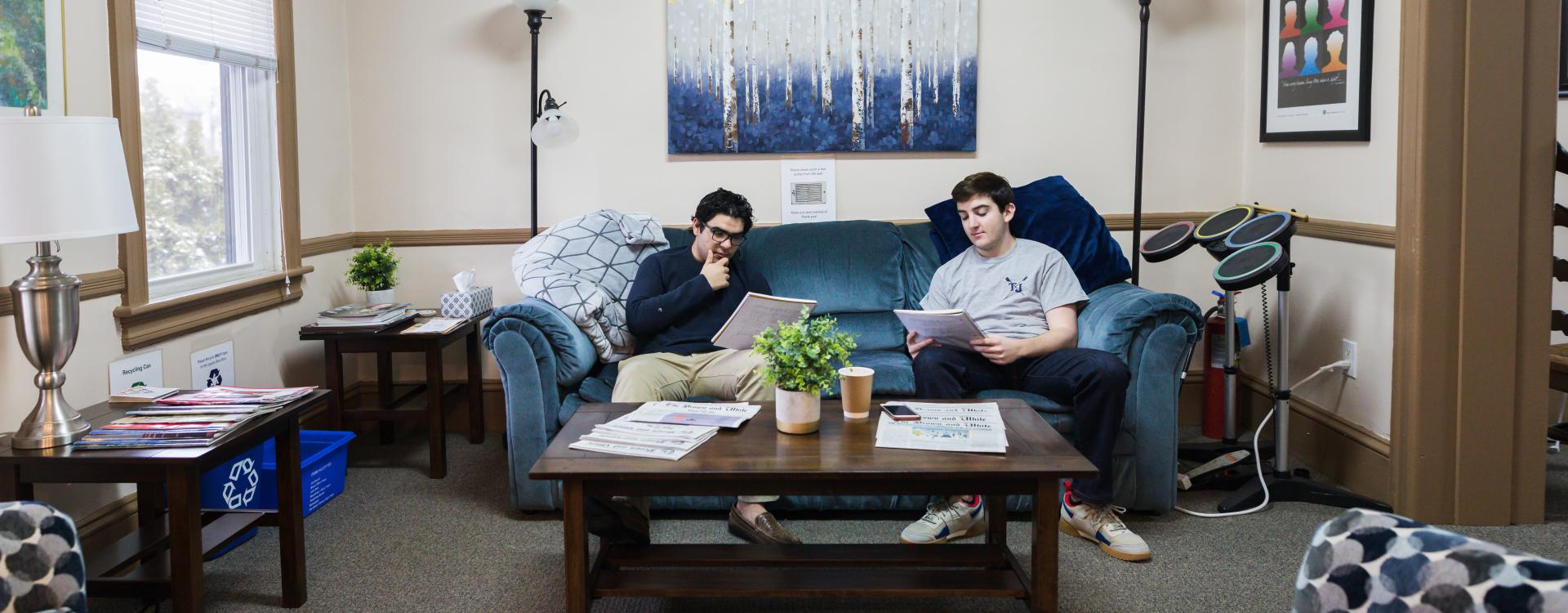 men hanging out on a couch